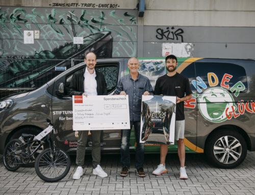 Rennrad-Profi Rick Zabel und Materna unterstützen die Stiftung Kinderglück